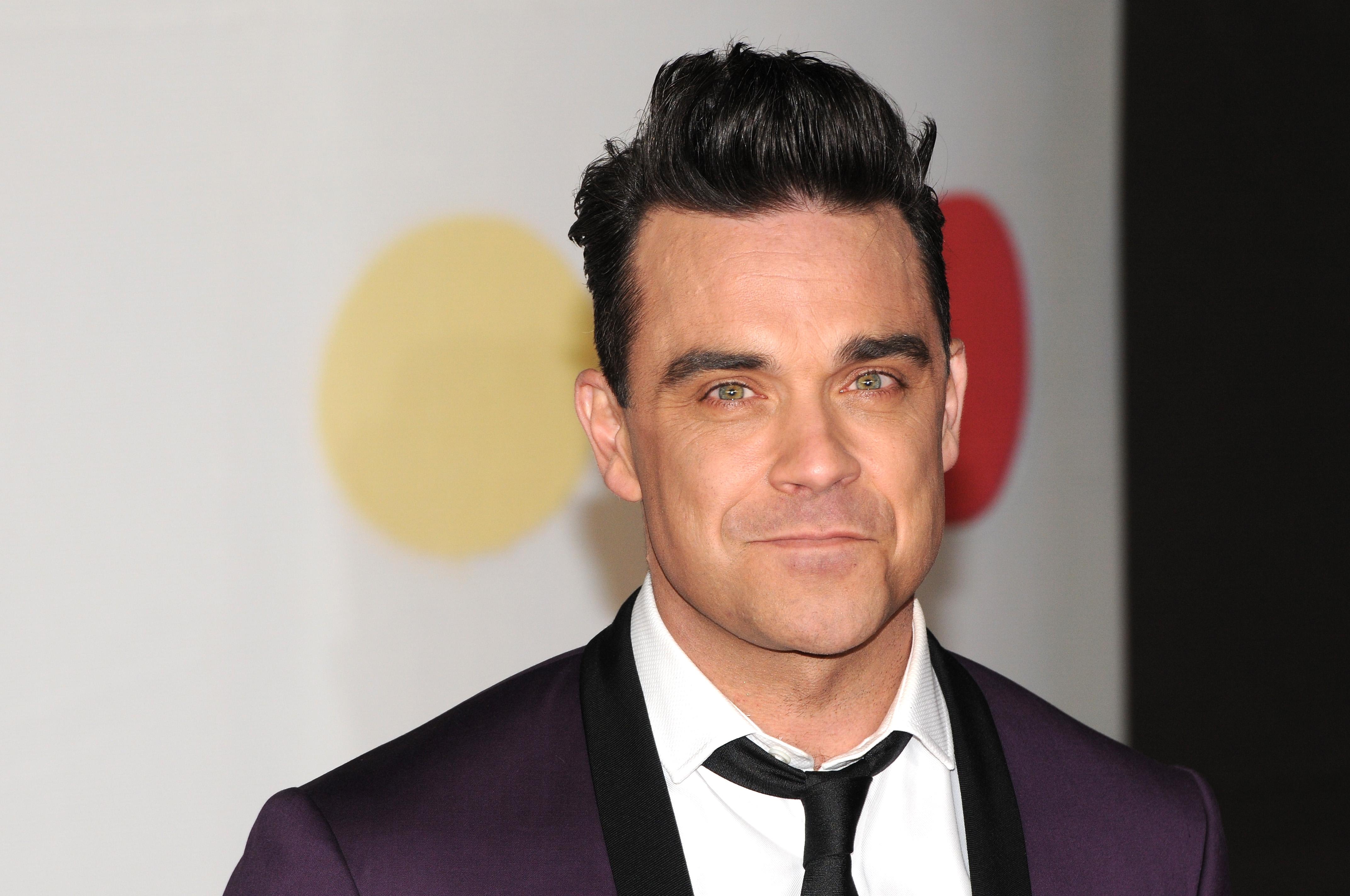 "Robbie Williams accusa i Take That: ""Troppo spendaccioni"""